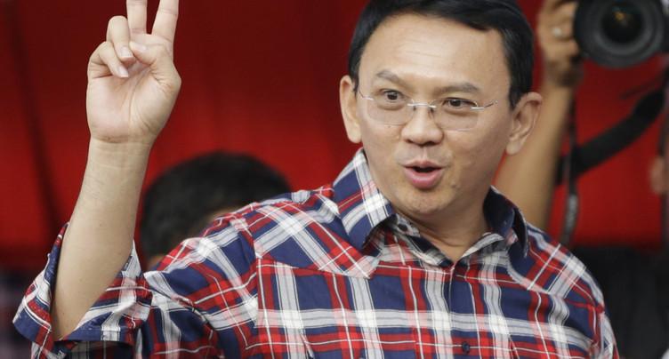 Le gouverneur sortant de Jakarta, chrétien, légèrement en tête