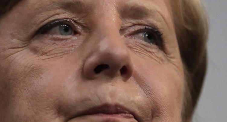 Affaiblie après les législatives, Merkel en quête d'alliés