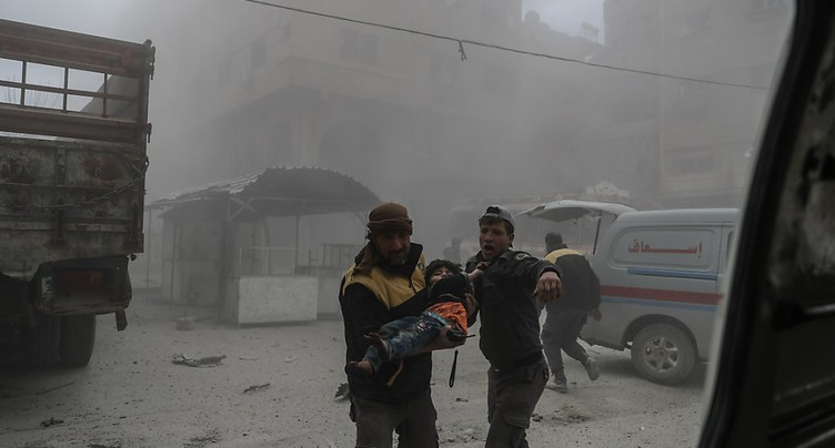 Ghouta: l'UE appelle à la trêve, Merkel et Macron exhortent Poutine