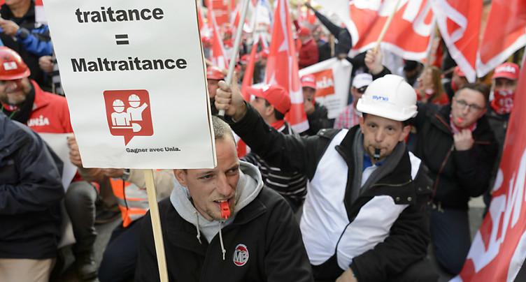 Des milliers d'ouvriers de la construction battent le pavé à Zurich