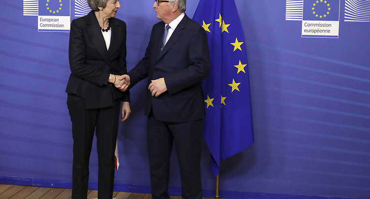 May rencontre Juncker à Bruxelles pour finaliser les négociations