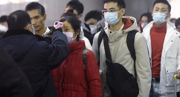 Face à l'épidémie, la Chine confine des villes entières