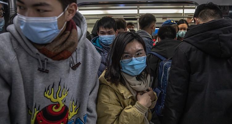 Pandémie: la Chine et l'OMS auraient pu agir plus vite (experts)