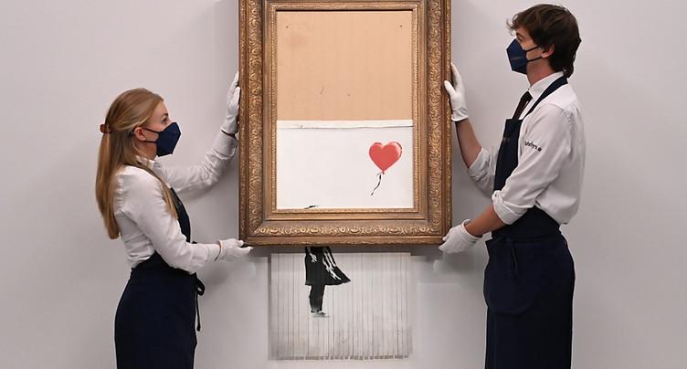 L'oeuvre de Banksy en partie autodétruite vendue 23,5 millions