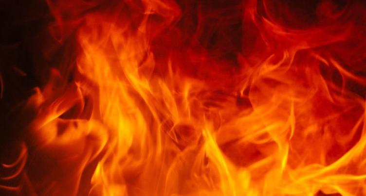 Poubelle enterrée en feu à Neuchâtel