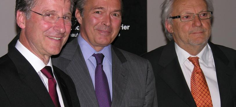Les représentants des marques Parmigiani et Chopard, Michel Parmigiani et Karl Scheufele, et le président de la Fondation Qualité Fleurier, Jean-Patrice Hofner